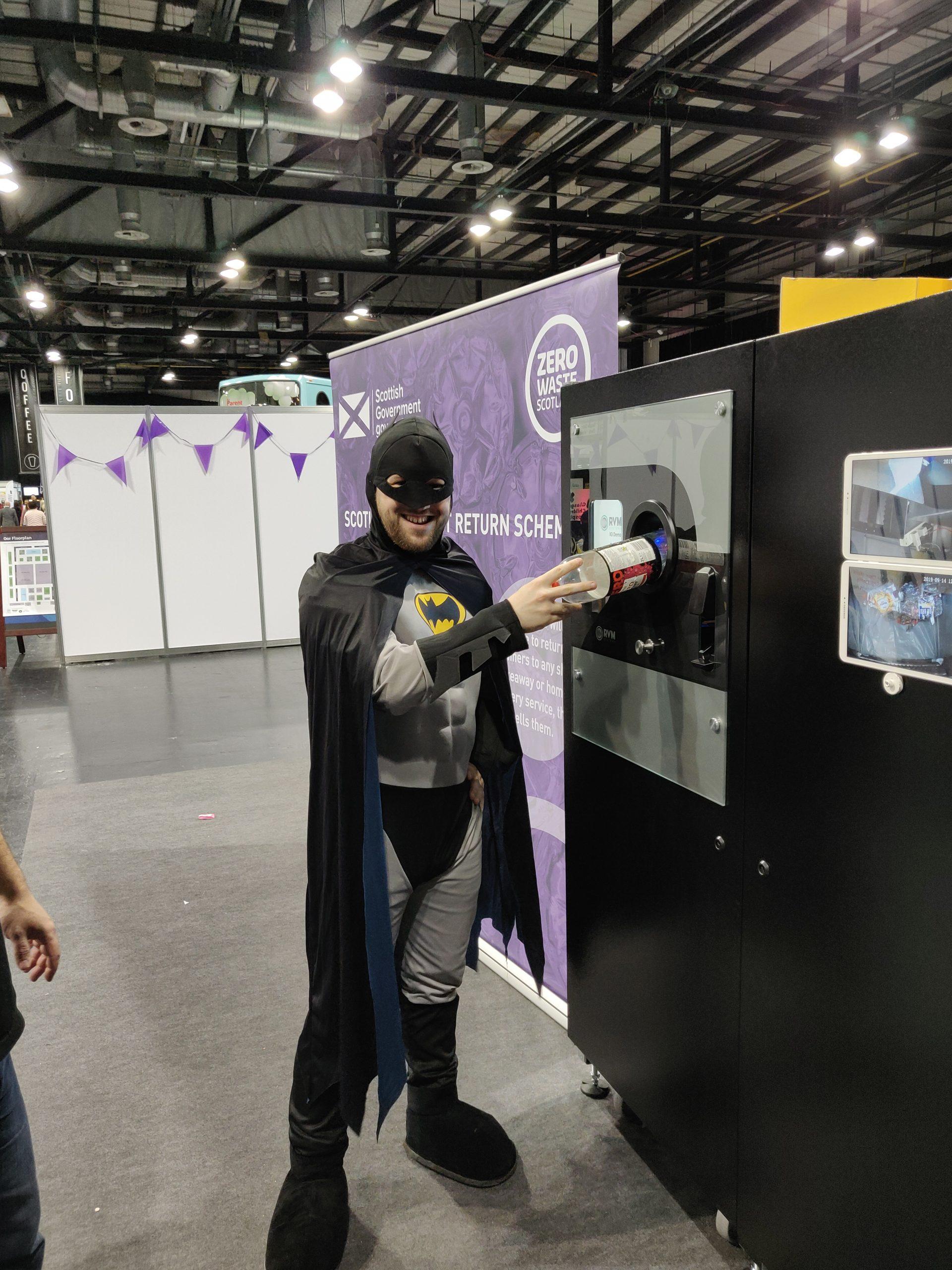 Batman using the Reverse Vending at Zero Waste Scotland Stand