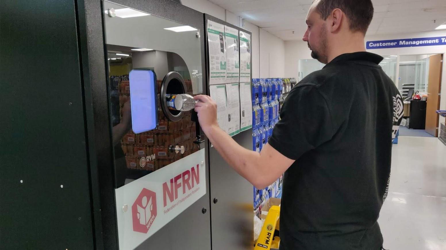 Richard using the NFRN Reverse Vending Machine
