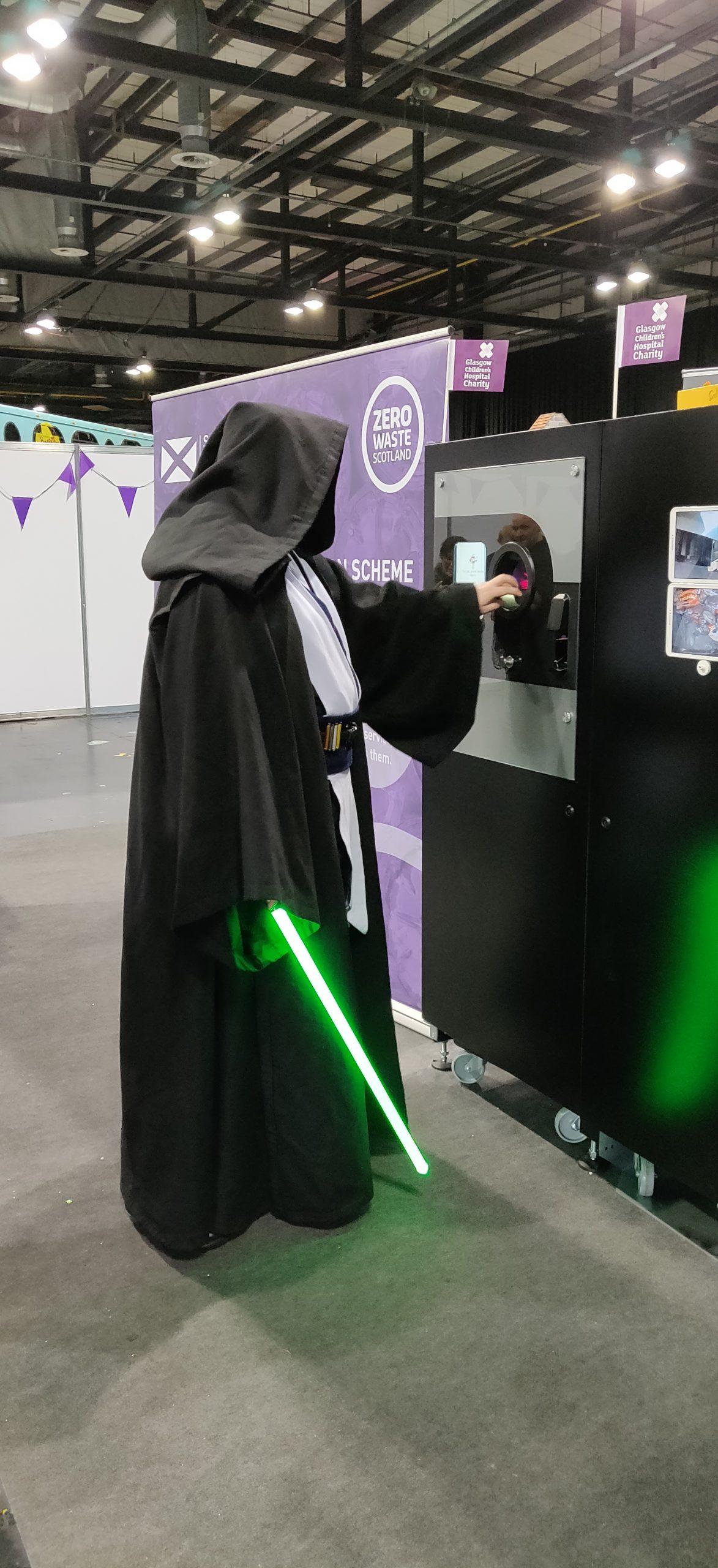 Obi Wan Kenobi using the Reverse Vending at Zero Waste Scotland Stand