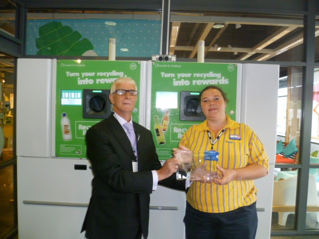 Left to right : , Jim McShee – Scottish Sales Manager – Reverse Vending Corporation presenting Award to Gina Jones , Marketing and Sustainability Specialist IKEA Glasgow.